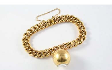 A GOLD CURB LINK BRACELET with concealed clasp and suspendin...
