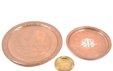 A Hugh Wallis hammered copper tray with central pewter motif, Johnnie Walker tray and small brass dish.