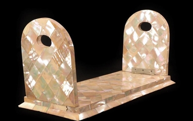 A Mother-of-Pearl Book Slide, mid 19th century, the arched ends...