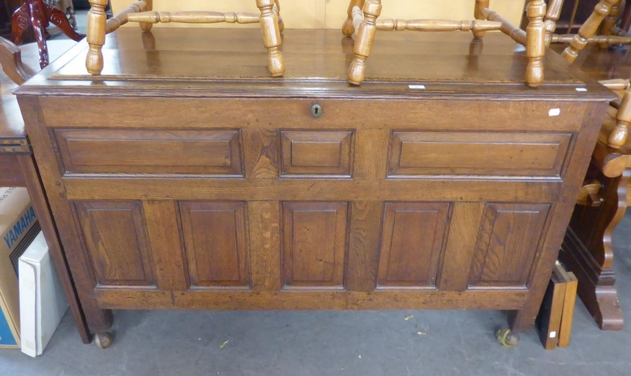 A NINETEENTH CENTURY OAK FIELDED PANEL CHEST WITH HINGED TOP