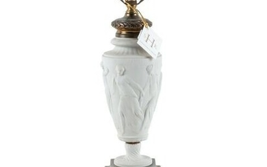 A Neoclassical Bisque Porcelain and Gilt Metal Mounted
