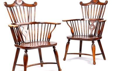 A PAIR OF ARTS AND CRAFTS BEECH AND ELM WINDSOR STYLE ARMCHAIRS LATE 19TH / EARLY 20TH CENTURY each with a rondel decorated comb top rail, above a stick and pierced splat back (2)