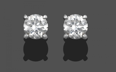 A Pair of Diamond Solitaire Stud Earrings, the round brilliant...