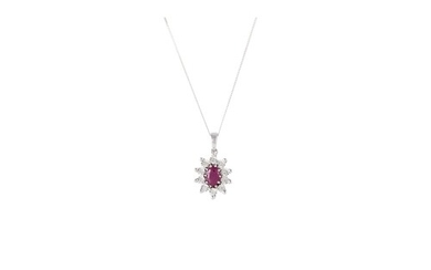 A RUBY AND DIAMOND PENDANT, mounted in 9ct white gold, on tr...