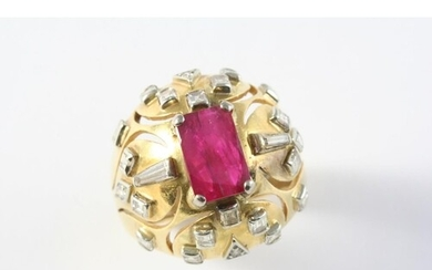 A RUBY AND DIAMOND RING the rectangular-shaped ruby is set w...