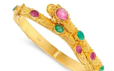 A RUBY AND EMERALD CHINESE DRAGON BANGLE in 22ct yellow