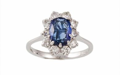 A SAPPHIRE AND DIAMOND CLUSTER RING, the oval sapphire weigh...