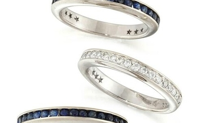 A SAPPHIRE AND DIAMOND TRIPLE HALF HOOP RING, formed of