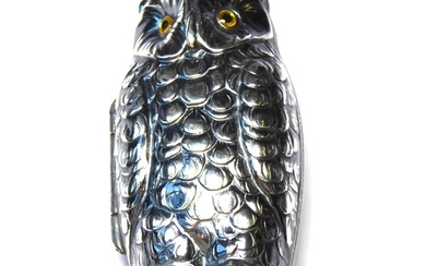 A SILVER PLATED NOVELTY OWL FORM SOVEREIGN CASE Having glass...