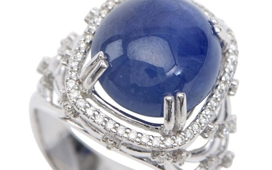 A STAR SAPPHIRE AND DIAMOND RING - The oval cut sapphire weighing 13.3cts, with diamonds set to the shoulders and surround totalling...