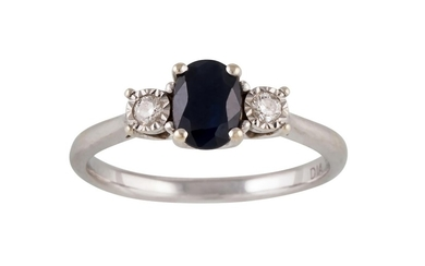 A WHITE GOLD THREE STONE DIAMOND AND SAPPHIRE RING