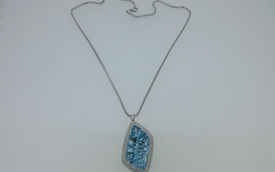 A blue topaz and diamond pendant and chain cased by
