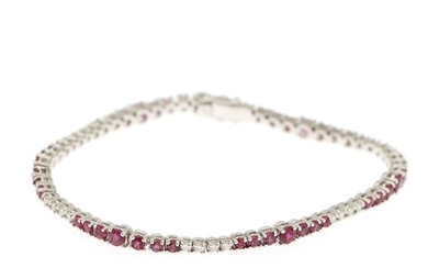 A bracelet set with numerous circular-cit rubies and brilliant-cut diamonds, mounted in 18k white gold. L. 17.5 cm.