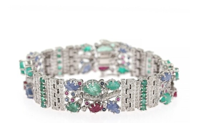 A diamond bracelet set with numerous brilliant-cut diamonds flanked by sapphires, emeralds and rubies, mounted in 14k white gold. L. app. 18.8 cm.