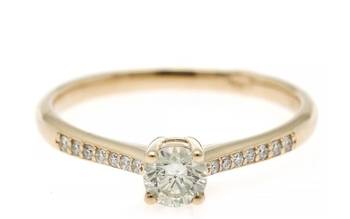 A diamond ring set with a brilliant-cut diamond flanked by numerous brilliant-cut diamonds totalling app. 0.38 ct., mounted in 14k gold. Size 53.