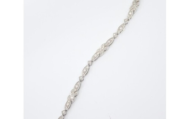 A diamond set 18ct gold bracelet total estimated weight of d...