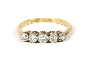 A gold five stone diamond ring