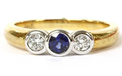 A gold sapphire and diamond three stone ring