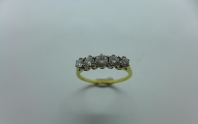 A hallmarked 9ct yellow gold five stone diamond ring, with f...