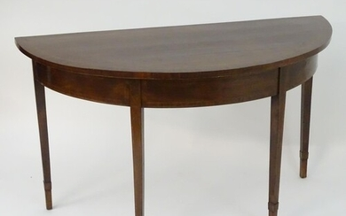 A late 18thC large mahogany demi lune console table with a d...