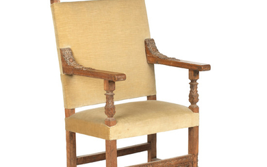 A late 19th century walnut framed and upholstered oversized chair, in the Carolean style