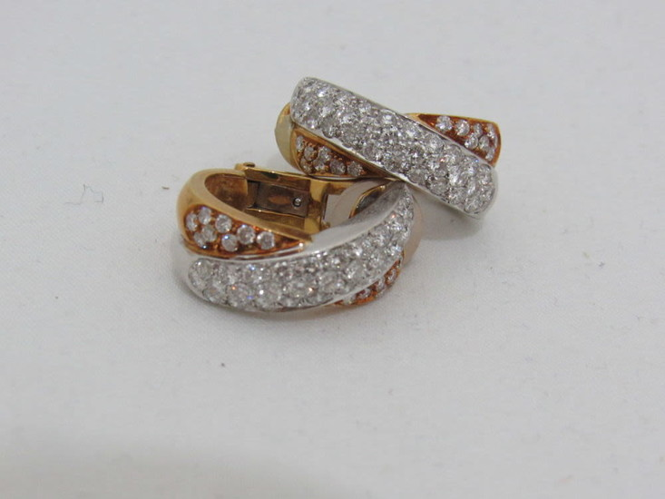 A pair of 18K white and yellow gold earrings,...