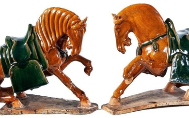 A pair of Chinese sancai-glazed pottery horses, 20th Century. Chips...