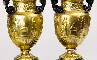 A pair of Neoclassical style gilt bronze urns