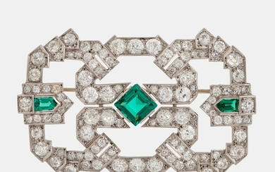 A platinum brooch set with old-cut diamonds and faceted green paste