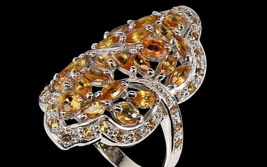 A sapphire ring set with numeropus oval and navette-cut orange and yellow sapphires, mounted in rhodium plated sterling silver. Size 58.