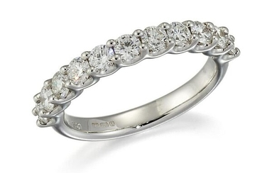 AN 18CT WHITE GOLD DIAMOND HALF HOOP RING, eleven round