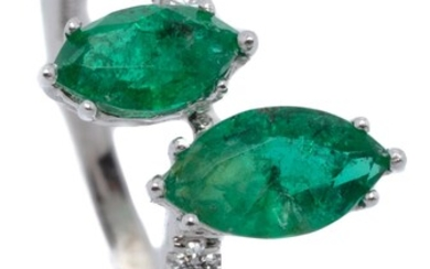 AN 18CT WHITE GOLD EMERALD AND DIAMOND RING; wave band centre set with two marquise cut emeralds totalling 0.86ct to shoulders set w...