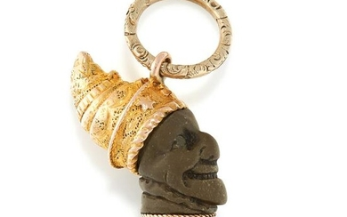 AN ANTIQUE CARVED LAVA PENDANT in yellow gold, designed