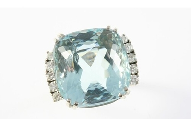 AN AQUAMARINE AND DIAMOND CLUSTER RING the cushion-shaped aq...