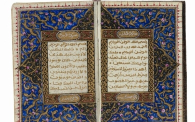 AN ILLUMINTATED MINIATURE OTTOMAN QURAN AND SILVER