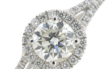 An 18ct gold diamond cluster ring, with diamond set shoulders.