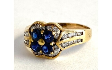 An 18ct sapphire and diamond cluster ring, four central sapp...