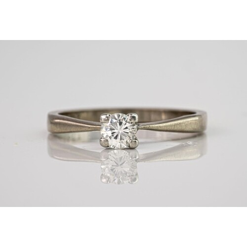 An 18ct white gold and diamond single stone ring, the brilli...