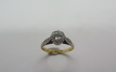An 18ct yellow gold and platinum solitaire diamond ring set ...