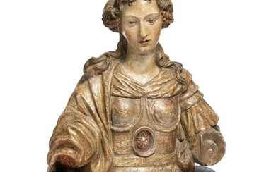 An Italian late Baroque bust. 17th century. H. 39 cm. Mounted onto a later base of wooden faux marbre.