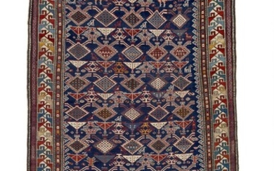 An antique Shirvan rug, Caucasus. All over stylized flowers in lattice design, top with two cocks surrounded by a stepped border. 1890–1910. 214×129 cm.