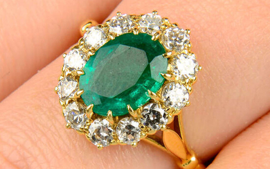 An emerald and old-cut diamond cluster ring.