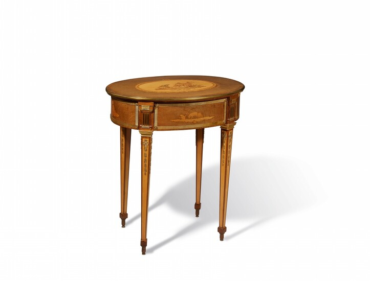 An oval working table by David Roentgen