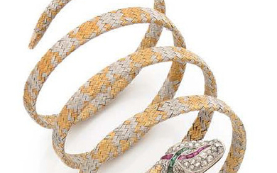 BRACELET ARMILLE in 18K (750) yellow and white gold braided forming a snake, the head paved with roses and enhanced by a line of calibrated rubies and emeralds.