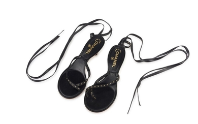 CHANEL | PAIR OF BLACK LEATHER THONG SANDALS