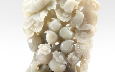 """CHINESE WHITE JADE CARVING Depicts flowers, fruits and birds. Height 8"""". With wood base."""