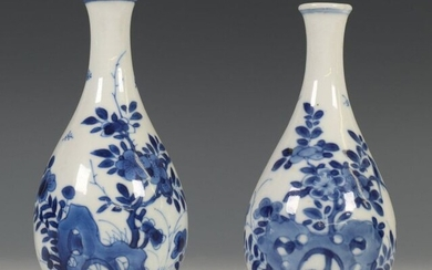 China, two blue-white porcelain vases, Kangxi, each decorated...