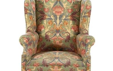 Chippendale style upholstered carved mahogany wingback chair