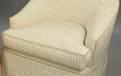 Custom upholstered club chair with upholstered ottoman.