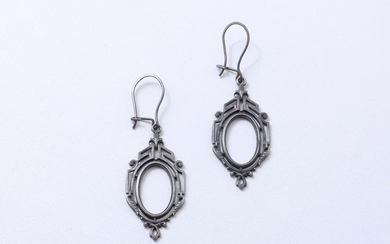 Delicate pair of earrings made of cast iron...